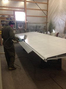 Levi painting a wing